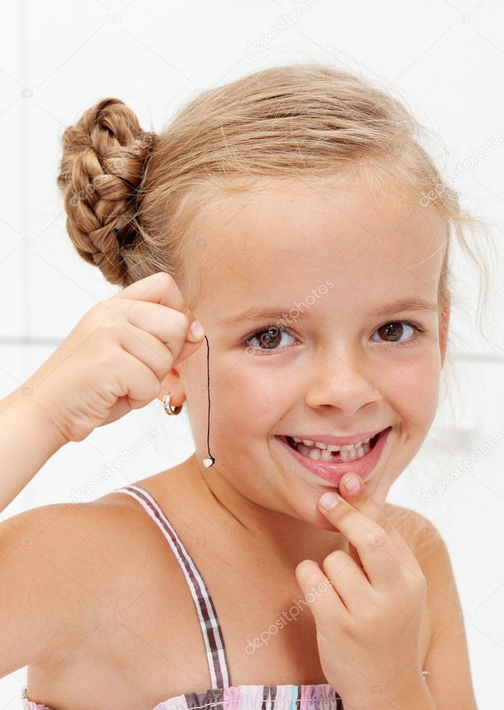 Little girl with her first missing milk tooth