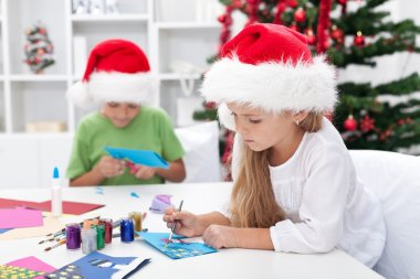 Kids making christmas greeting cards