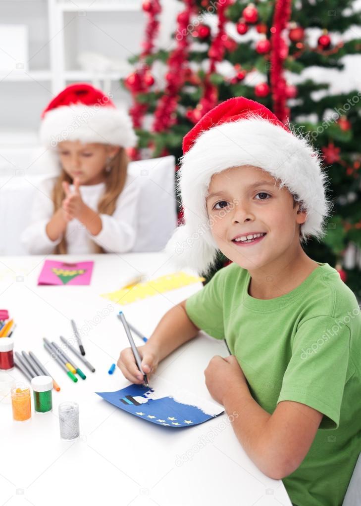Kids making christmas greeting cards stock photo ilona75 15735451 kids making christmas greeting cards stock photo m4hsunfo