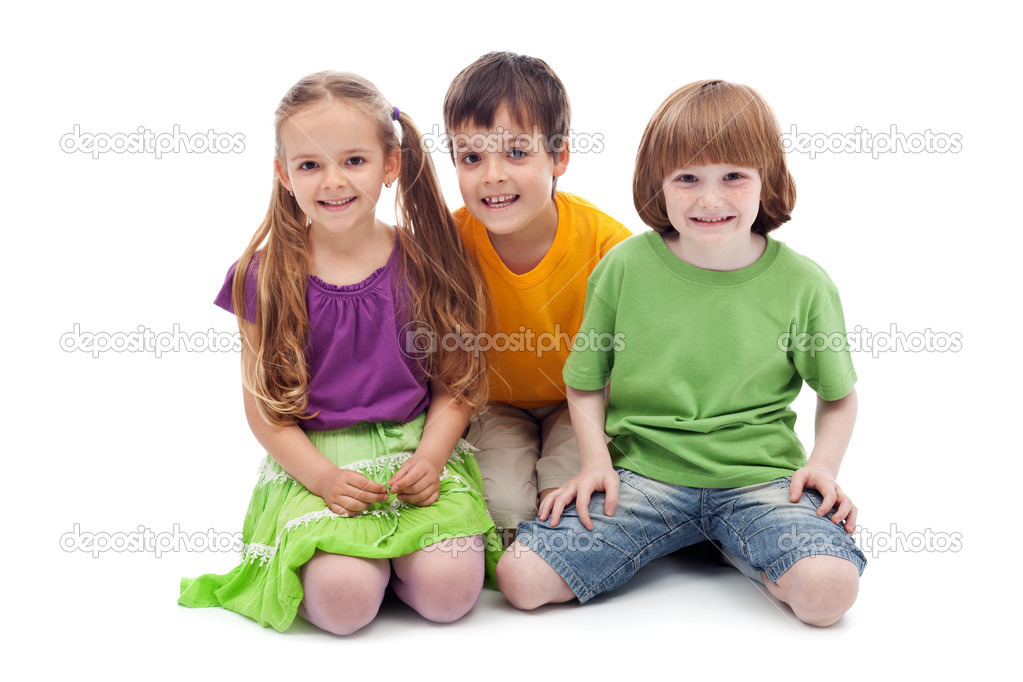 Happy kids sitting on the floor