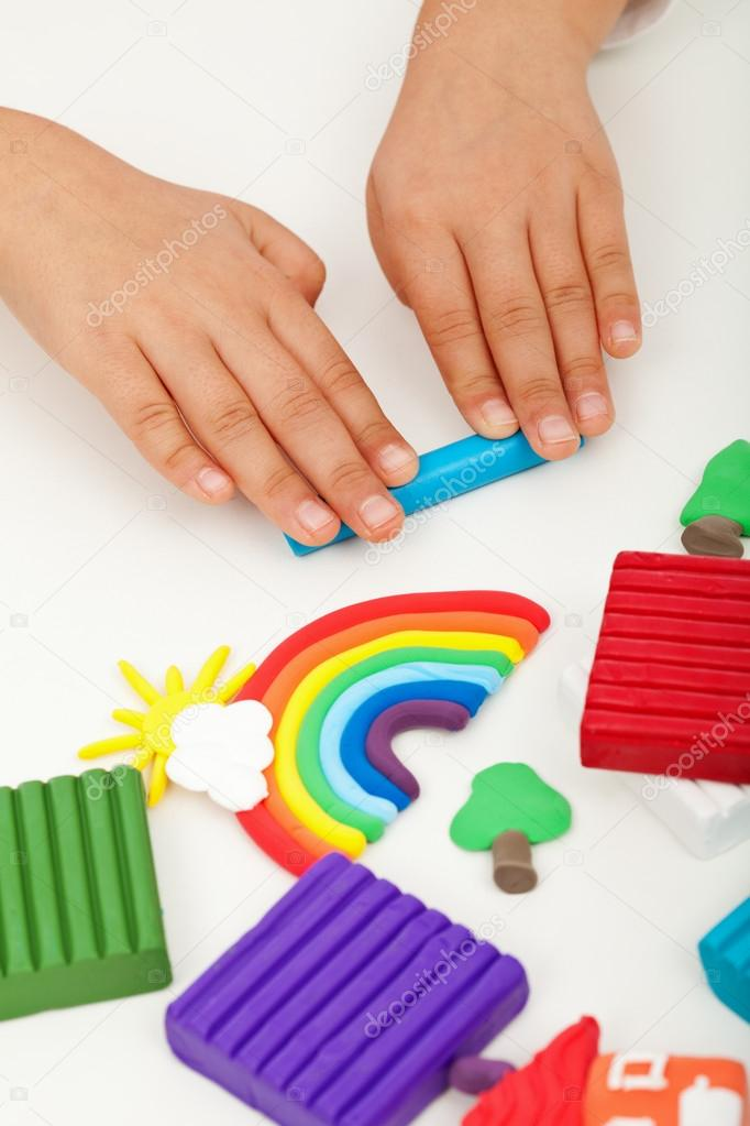 Child hands with modelling clay