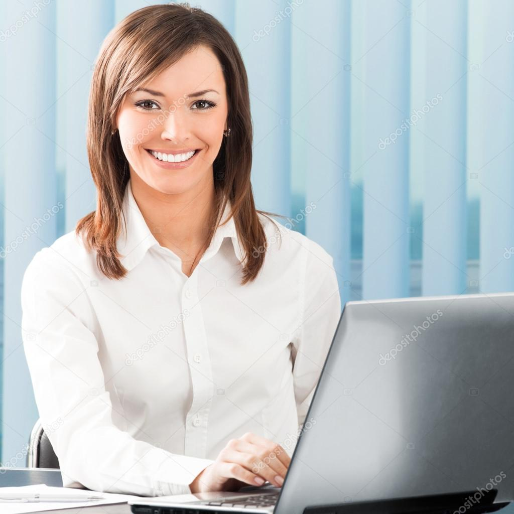 Portrait of successful happy smiling business woman working with laptop at office