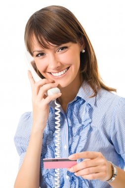 Young happy smiling business woman with plastic card, on phone