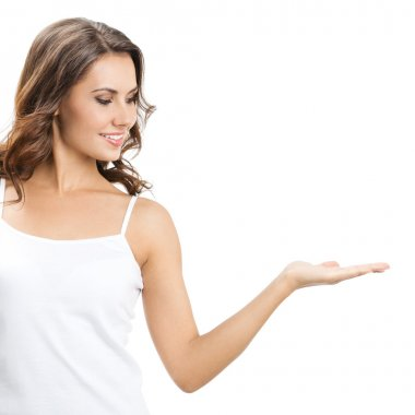 Beautiful young woman showing something