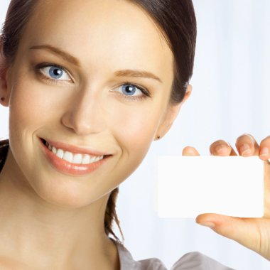 Business woman giving blank business card, at office