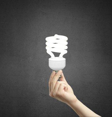 hand holding e lamp