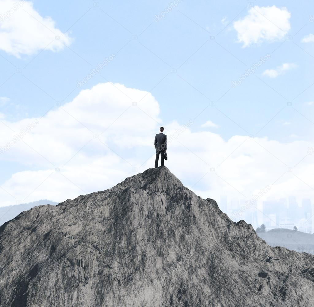 businessman on mountain