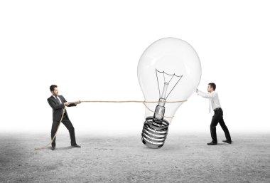 two man pulling lamp