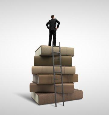 businessman standing on books