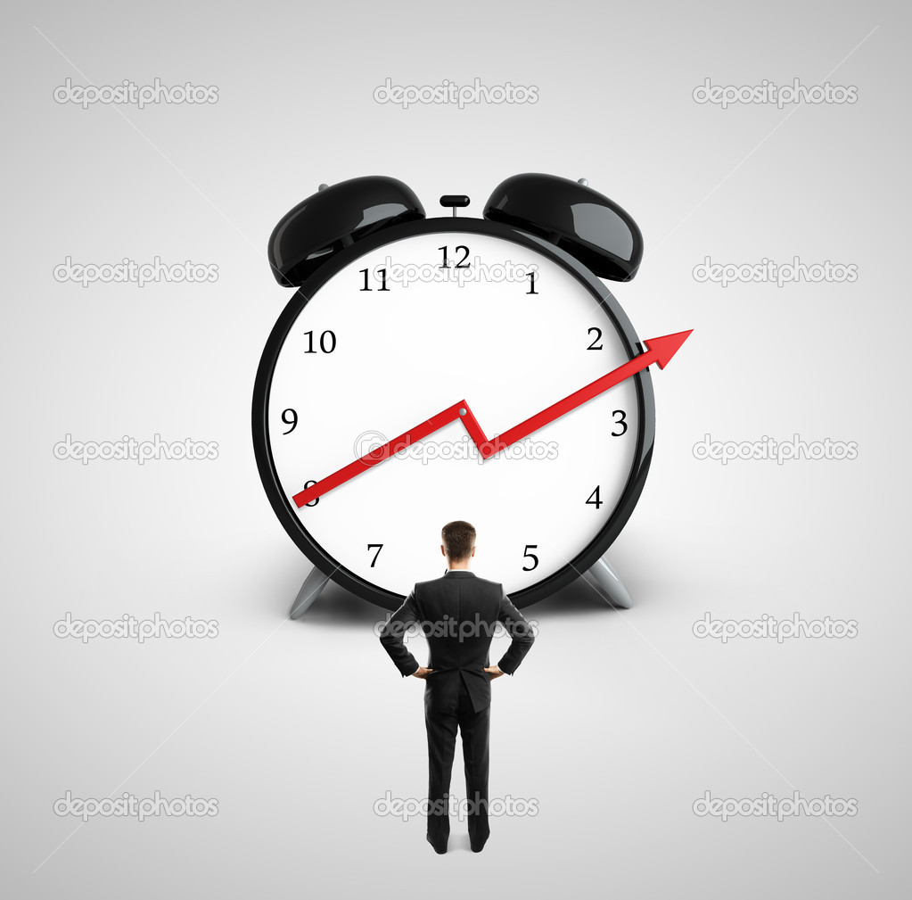 man looking at clock stock photo peshkova 32318119