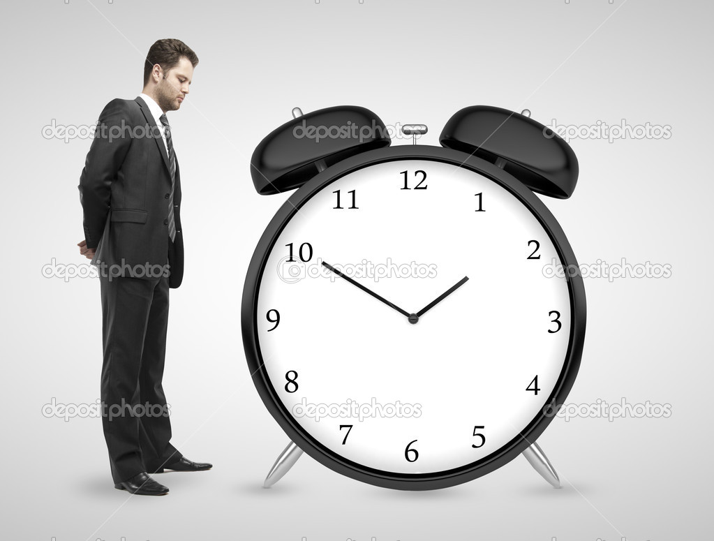 man looking at clock stock photo peshkova 32760813