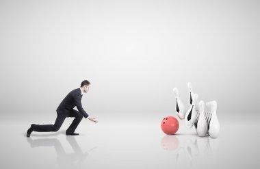 businessman playing bowling