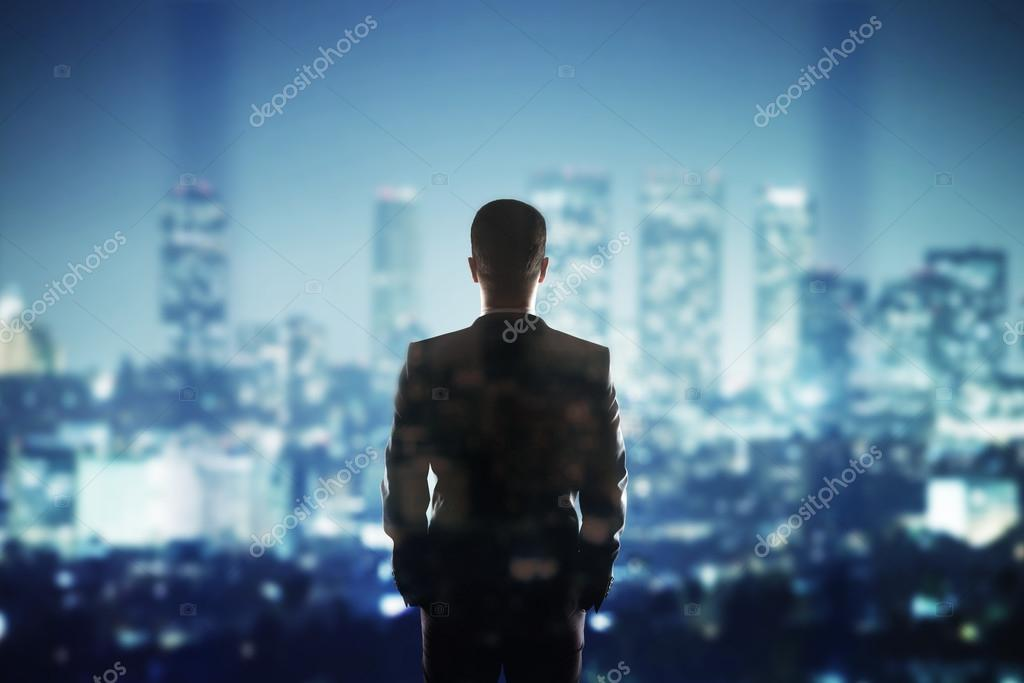 man looking to city