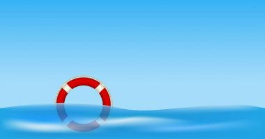 Red life buoy floating on water