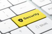 Fotografie Datenschutz-Konzept: Computer-Tastatur mit Schild mit Schlüsselloch und