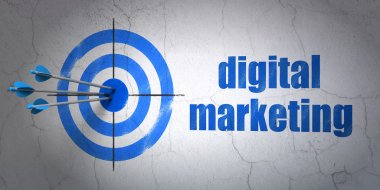 Marketing concept: target and Digital Marketing on wall background