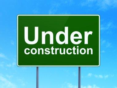 Web design concept: Under Construction on road sign background