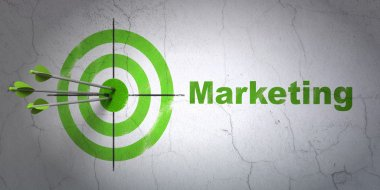 Marketing concept: target and Marketing on wall background