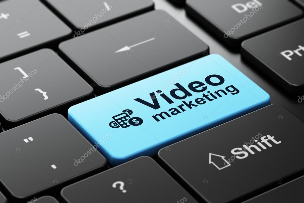 Finance concept: Calculator and Video Marketing on computer keyboard background