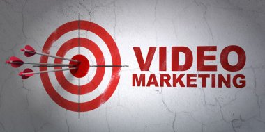Business concept: target and Video Marketing on wall background