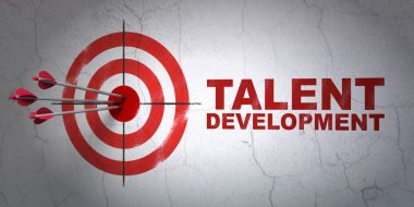 Education concept: target and Talent Development on wall background