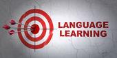 Fényképek oktatási koncepció: cél és a nyelvtanulás a fal háttér
