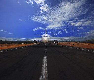 Passenger air plane running on airport runway with beautiful blue sky with white cloud use for transport and traveling journey background