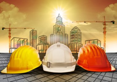 Safety helmet and building construction sketching on paper work use for construction industry business and architecture engineering topic