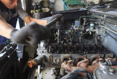 hand repair and maintenance top of  cylinder diesel engine block