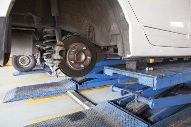 maintenance of sedan car suspension shock absorber and brake cal