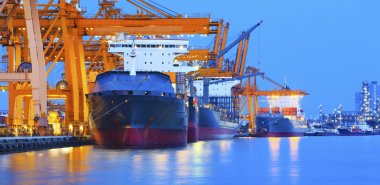 Ship yard with heavy crane in beautiful twilight of day use for import export industry and international trading