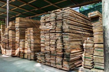 stack of pile wood bar in lumber yard factory use for constructi