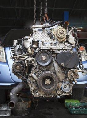 Old diesel engine of light truck maintenance in garage service