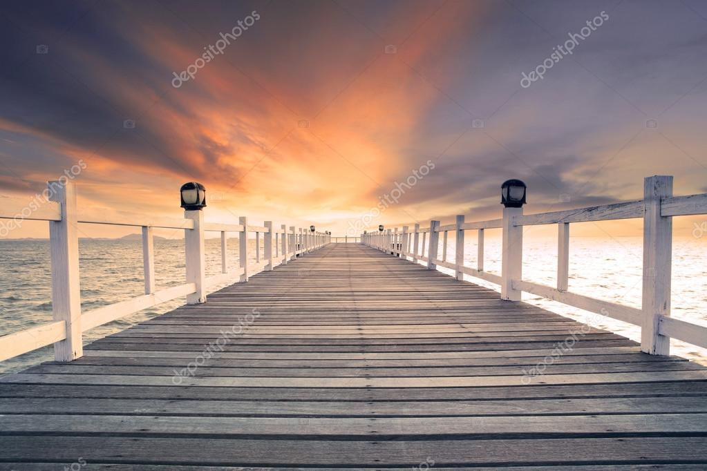 old wood bridg pier with nobody against beautiful dusky sky use