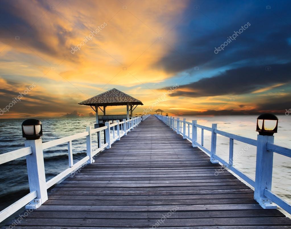 Wood piers and sea scene with dusky sky use for natural background ,backdrop wood piers and sea scene with dusky sky use for natural background ,backdrop