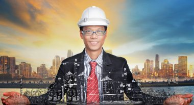 Young engineer and his urban development project use for construction industry and urban land development topic
