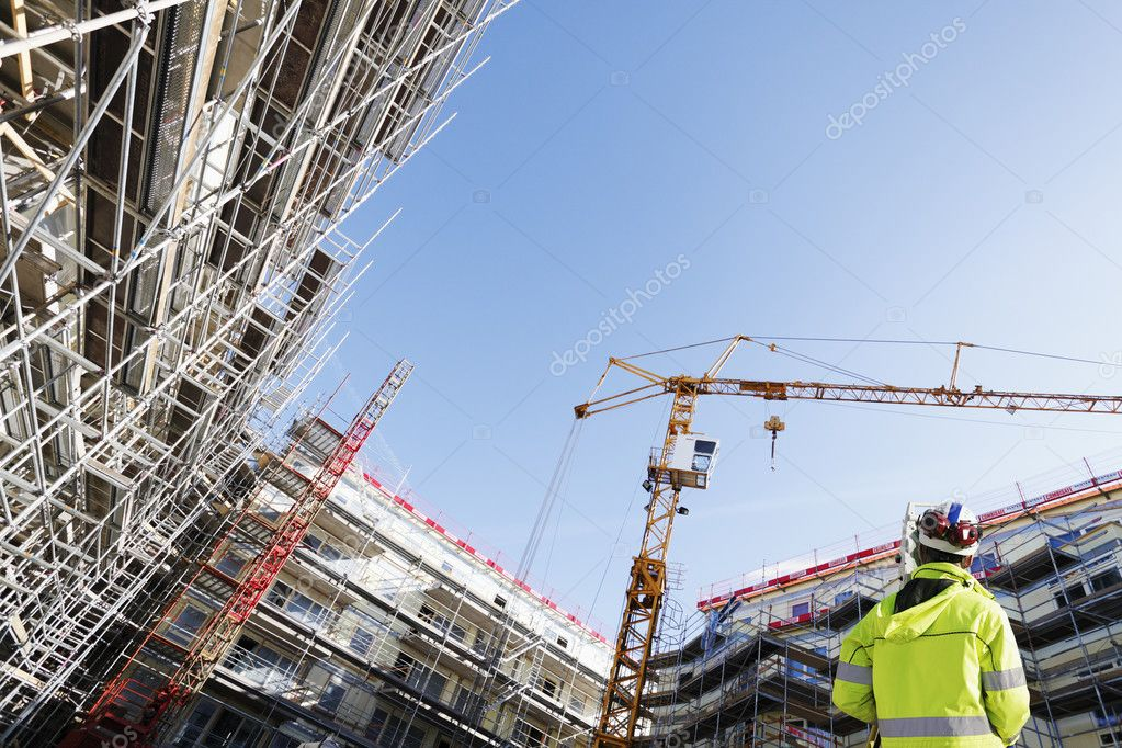 surveyor inside large building site