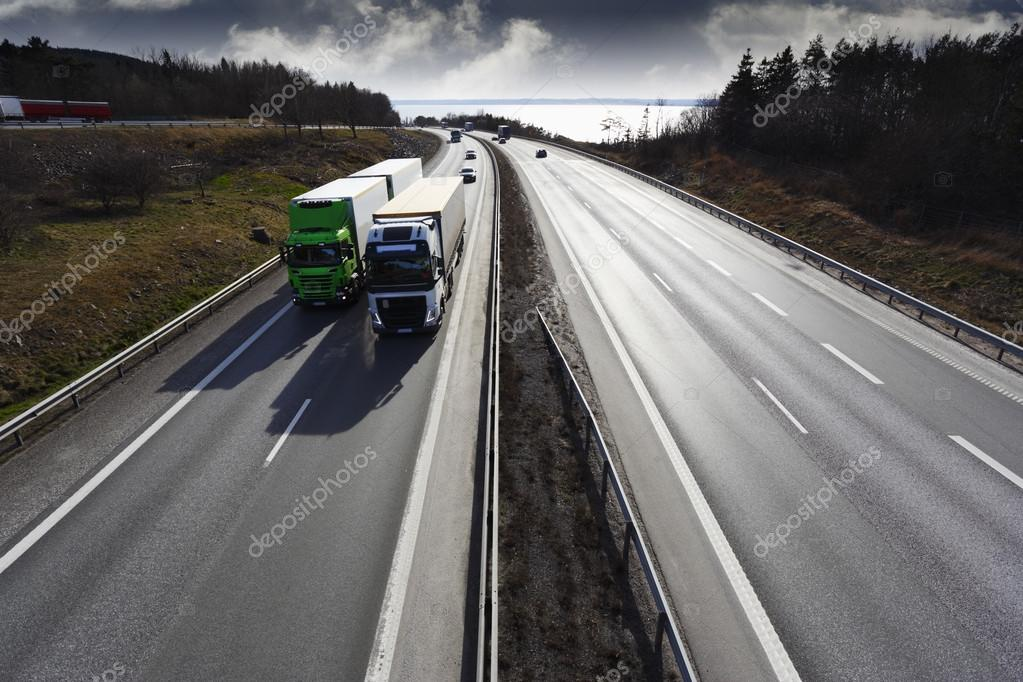 Trucks driving on straight highway