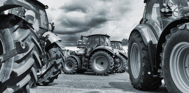 Farming tractors on a line-up