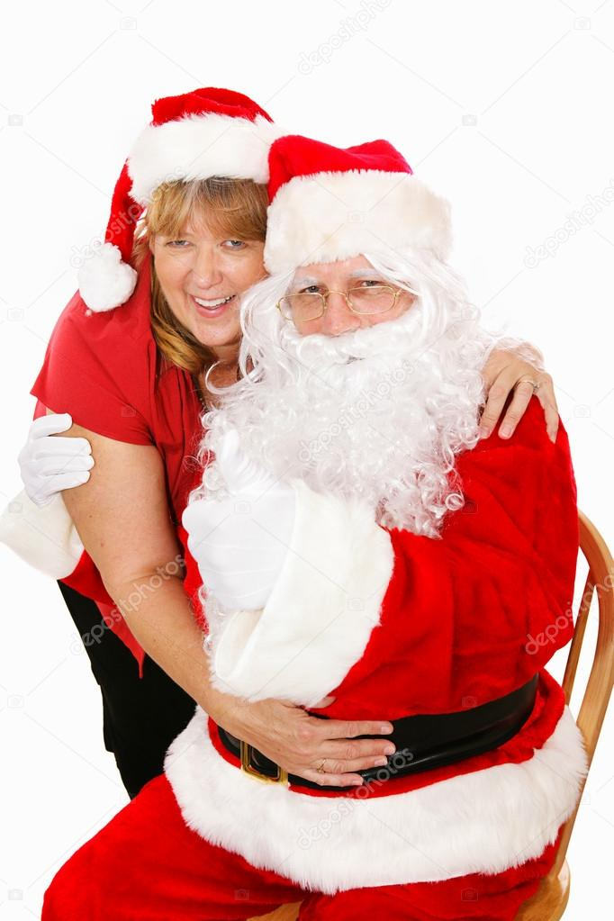 Cute Portrait Of Santa Clause Getting A Hug From His Wife Isolated On White Photo By Lisafx