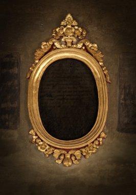 Golden frame over vintage wallpaper