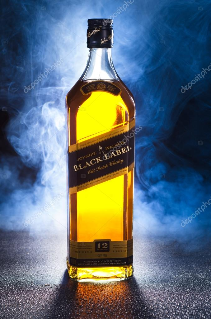 Johnnie Walker Whiskey With Smoke On Black Background Stock