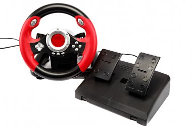 Game console with a steering wheel and pedals.