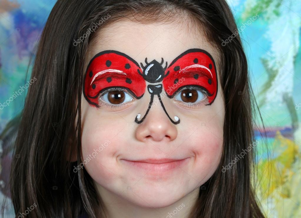 Pretty Girl With Face Painting Of A Ladybug Stock Photo