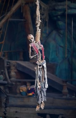 A pirate skeleton hanging from a noose