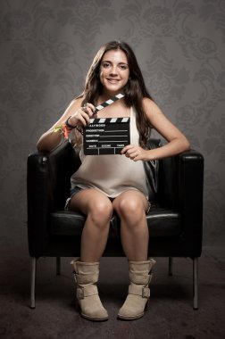 young woman with movie clapper board