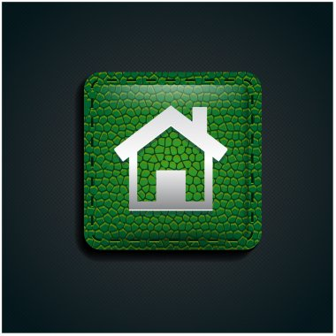 Home button icon on green leather