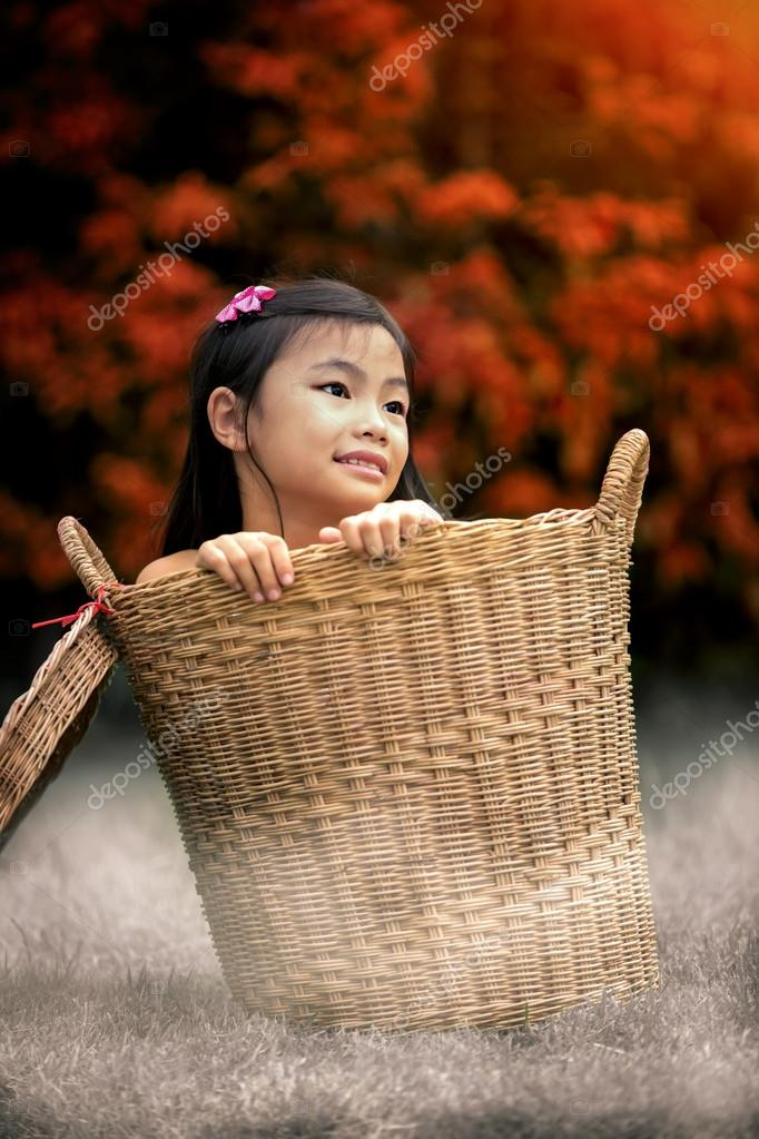 Young girl Sitting In Basket