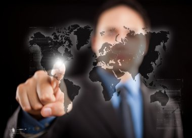 Man pointing his finger on a digital world map stock vector