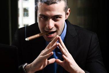 Shady man smoking a cigar